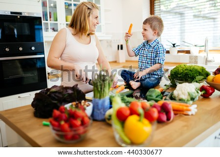 Mother and child preparing lunch from fresh veggies - stock photo