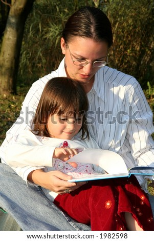 Mother and child reading - stock photo