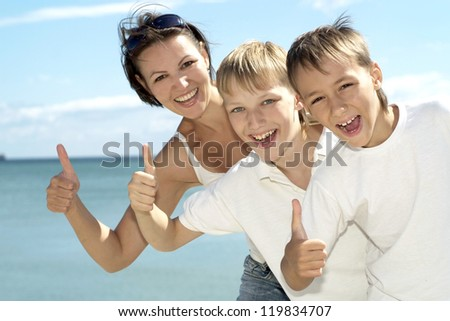 Mother and children on the background of the sea - stock photo