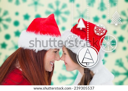 Mother and daughter against snowflake pattern - stock photo