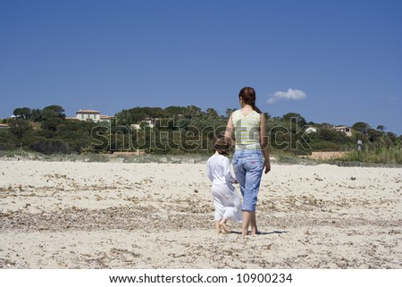 mother and daughter at the beach - saint-tropez, french riviera - stock photo