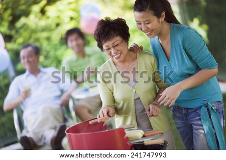 Mother and Daughter Barbecuing - stock photo