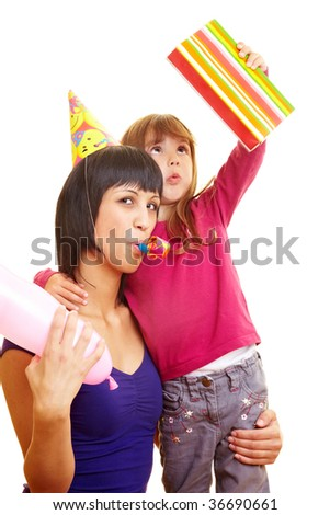 Mother and daughter celebrating a birthday - stock photo