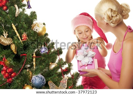 Mother and daughter celebrating christmas - stock photo
