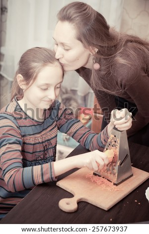 Mother and daughter cooking - stock photo