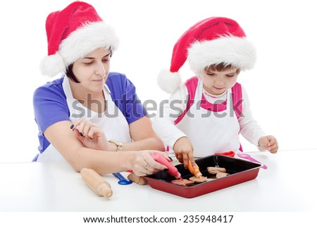 Mother and daughter decorating gingerbreads together - stock photo