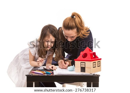 Mother and daughter drawing together at table isolated on white background - stock photo