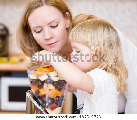 Mother and daughter eating fruits - stock photo