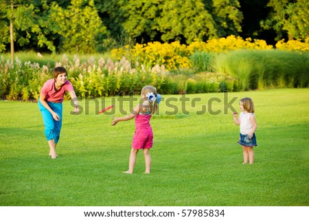 Mother and daughter enjoying frisbie leisure time - stock photo