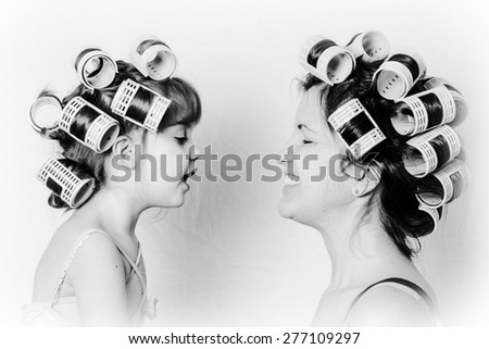 mother and daughter girlfriends, great parenting or motherhood image, black and white, vintage and retro shot. - stock photo
