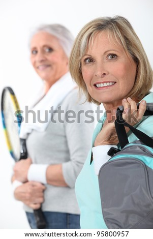 Mother and daughter going to the gym together - stock photo