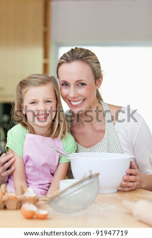 Mother and daughter having a good time in the kitchen - stock photo