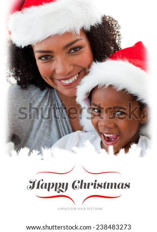 Mother and daughter having fun at Christmas time against border - stock photo