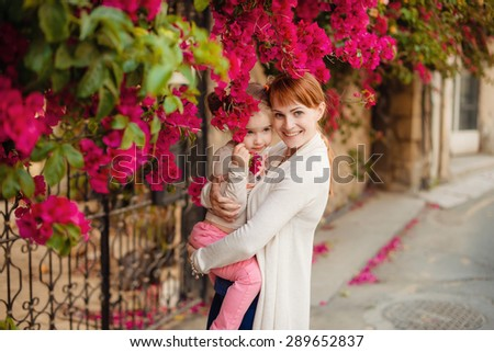 Mother and daughter hugging, happiness, happy family - stock photo