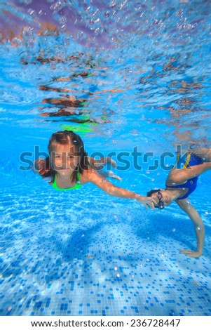 Mother and daughter in a swimming pool - stock photo