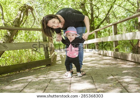 Mother and daughter in forest - stock photo