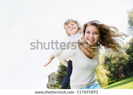 Mother and daughter in park - stock photo