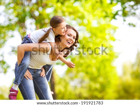 Mother and daughter in park. Mother Day. - stock photo