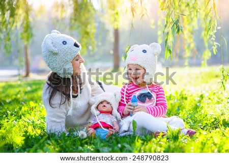 mother and daughter in the park. - stock photo