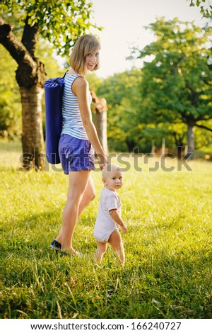 Mother and daughter is going on yoga class  - stock photo