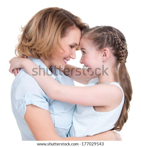 Mother and daughter look at each other - portrait on isolated  white background  Happy family people concept. - stock photo