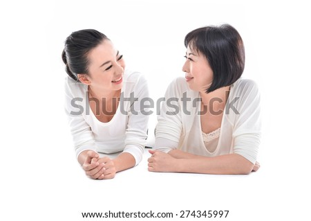 Mother and daughter lying down  - stock photo