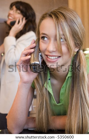 Mother and Daughter on phone - stock photo
