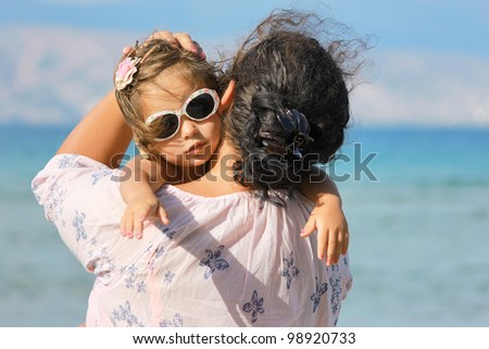 Mother and daughter on the sea - stock photo