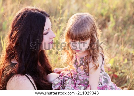 Mother and daughter outdoor - stock photo