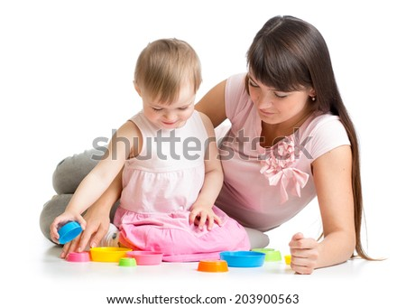mother and daughter play together with cup toys - stock photo