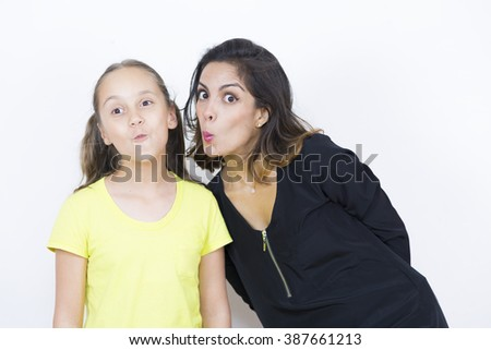 Mother and Daughter Playing Together on white background - stock photo