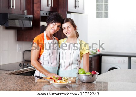 mother and daughter portrait in kitchen - stock photo