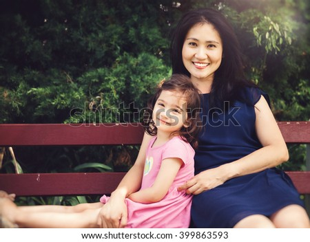 mother and daughter portrait outdoors - stock photo