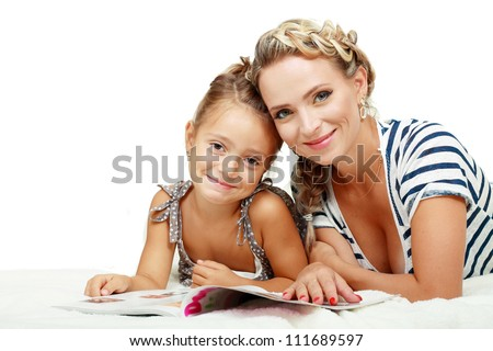 Mother and daughter reading journal on white background. - stock photo