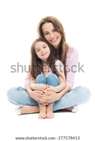 Mother and daughter sitting - stock photo