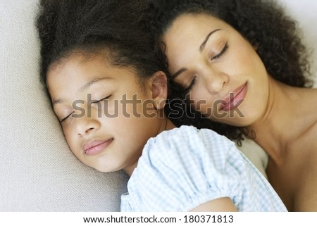 Mother and daughter sleeping - stock photo