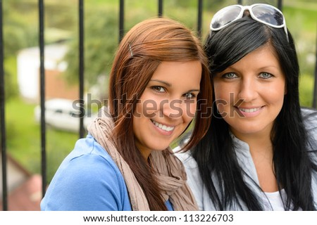 Mother and daughter smiling relaxing and bonding together comfortable teen - stock photo