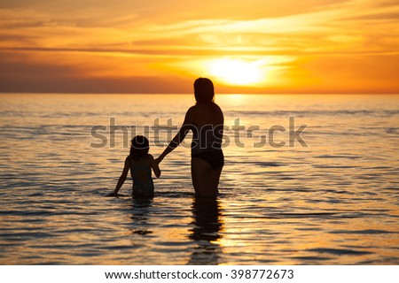 Mother and daughter spending quality time together - stock photo