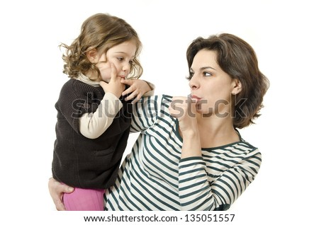 Mother and daughter suck their thumbs on white background. - stock photo