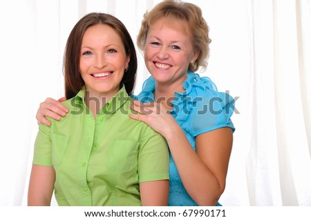 Mother and daughter together. Symbol of the family. - stock photo