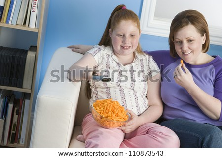 Mother And Daughter Watching TV - stock photo