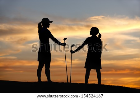 Mother and daughter with drivers. - stock photo
