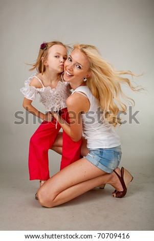 Mother and daughter with flower. - stock photo