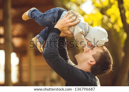 Mother and her child enjoy the summer in park. Outdoors. - stock photo