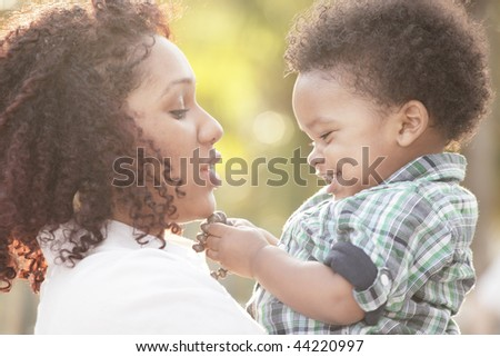 Mother and her cute son - stock photo
