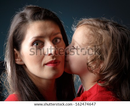 Mother and her daughter in an artistic portrait - stock photo