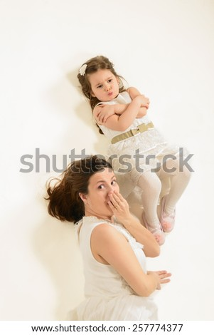 Mother and her little lovely daughter, concept of togetherness, studio shot. Mother and daughter having fun playing Happy family concept. - stock photo