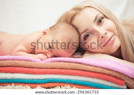 Mother and her Newborn Baby. Happy Mother and Baby kissing and hugging. Maternity concept. Parenthood. Motherhood - stock photo