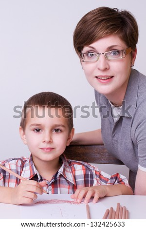mother and his young boy learning at home - stock photo