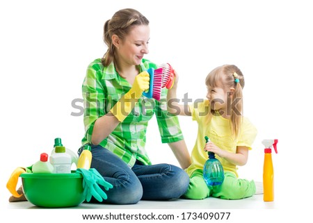 mother and kid clean room having fun - stock photo